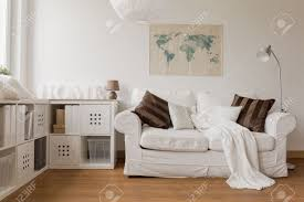 white sofa and commode in cozy living room stock photo picture