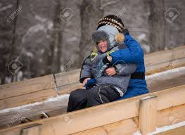 happy enjoying on sledge winter rides stock photo