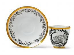 a porcelain cup and saucer with sickle and wheat sheaf decor