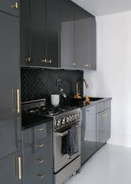 grey kitchen cabinets with black countertops outofhome
