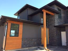modern home by mdt homes kamloops bc with charcoal ledgestone
