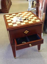 bombay game table with playing pieces for chess