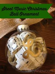 sheet music christmas ball ornament that i made for my piano