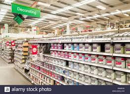 Homebase Decorating Tins Of Paint At Homebase Store England Uk Stock Photo Royalty