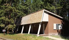cabin house which yellowstone hotel or cabin should i choose in the summer