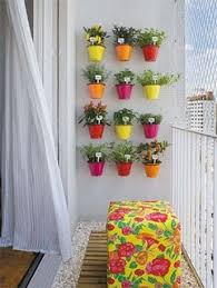 small bucket herb garden on wall could attach with command hooks