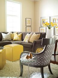 contemporary living room design with dark sofa cushion and bay