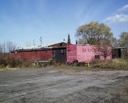 box car living in dryden railroad drinking
