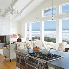 beach cottage living room with wood flooring and sloped ceiling
