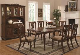 dining room six chairs in brown and a brown square table then
