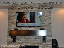 top 74 great tv over fireplace heat can i mount a tv above a gas fireplace can you put a tv over a fireplace can you mount a tv over a wood