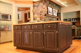 brown wooden island with four drawer and cabinet door in white