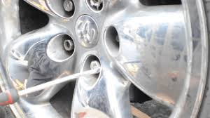 nissan altima lug nut size how to remove chrome caps from lug nuts youtube