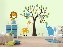 17 nursery wall decals and how to apply them keribrownhomes bedroom nursery wall decals forest animals and jungle theme with tree owl monkey elephant giraffe