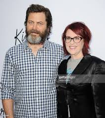actor nick offerman and actress megan mullally attend the premiere of picture id169612389