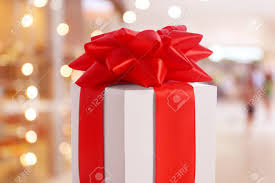 big present bow present box with big bow against blurred background stock