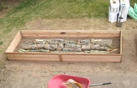How To Install A Raised Garden Bed - diy hugelkultur how to build raised permaculture garden beds