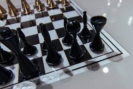 motorized chess table with ilaid chess board by vismara design