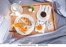 breakfast bed tray coffee croissants jam stock photo 659564404