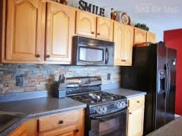 kitchens with black appliances and oak cabinets slate tile backsplash from lowes with golden oak cabinets gray