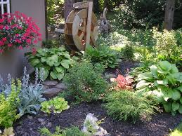 back yard with raised bed vegetable garden plus wooden fence of