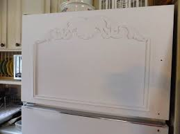 once i had the trim adhered i started to paint the fridge with annie sloan pure white