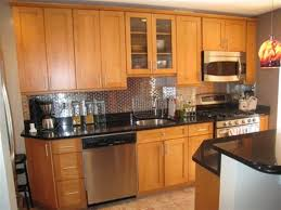 light wood kitchen cabinets with black countertops marvelous honey maple pantry cabinet with cabinet