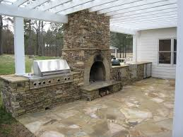 modern outdoor kitchens stone fireplace and flagstone floor for modern outdoor kitchen