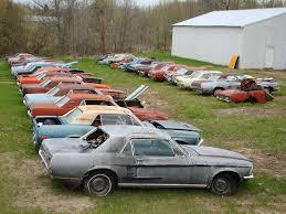 mustang salvage yard junk cars own a mustang junk yard rustingmusclecars