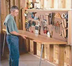 How To Make A Fold Down Workbench How Tos Diy by 35 Diy Garage Storage Ideas To Help You Reinvent Your Garage On A