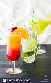 margarita on the beach margarita mint mojito and tequila sunrise cocktails stock photo