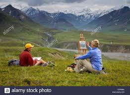 male pencil sketch artist and female oil painting artist sitting