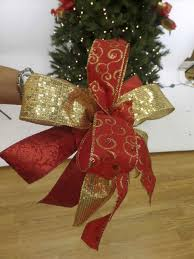 christmas tree decorations with gold ribbons ne wall