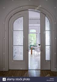wood and glass sliding doors in arched doorframe chelsea