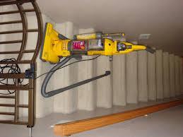 vacuuming stairs u2014 patchwork times by judy laquidara