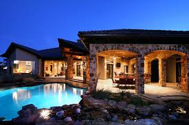 exterior interior home house pool house stone pool tv table chairs