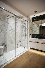 bathroom shower with long glass doors and chrome railing modern