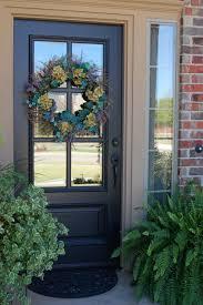 turquoise front door beyond screen door