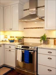 kitchen stainless steel stove metallic tiles kitchen backsplash