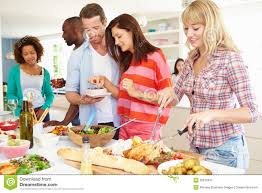 group of friends having dinner party at home royalty free stock