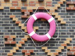 pink and white buoy on black brick wall free image peakpx