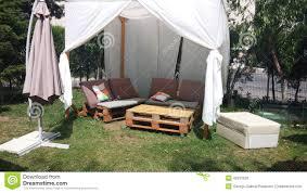 Garden Table With Umbrella Garden Table With Iron Chairs And Sun Umbrellas Stock Photo