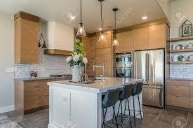 light brown kitchen cabinets designs sleek white kitchen island amongst modern light brown cabinetry