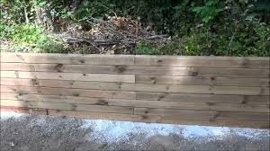 cedar landscape timbers vapour barrier to protect landscaping lumber retaining wall youtube