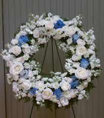 cpd sympathy wreath blue white in brighton ma centre pieces