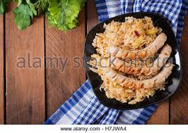 munich sausages with fried cabbage top view stock photo royalty