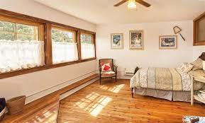 craftsman guest bedroom with flush light hardwood floors in