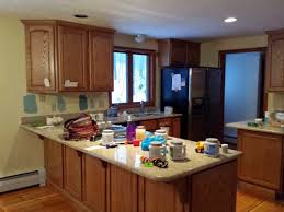 wood kitchen cabinets painted white should we paint these oak cabinets white white