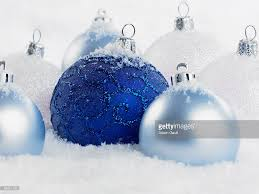 close up of blue christmas ornaments in snow stock photo getty