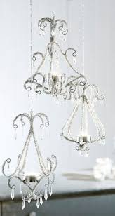 my chandelier using strings of pearls crystals and an